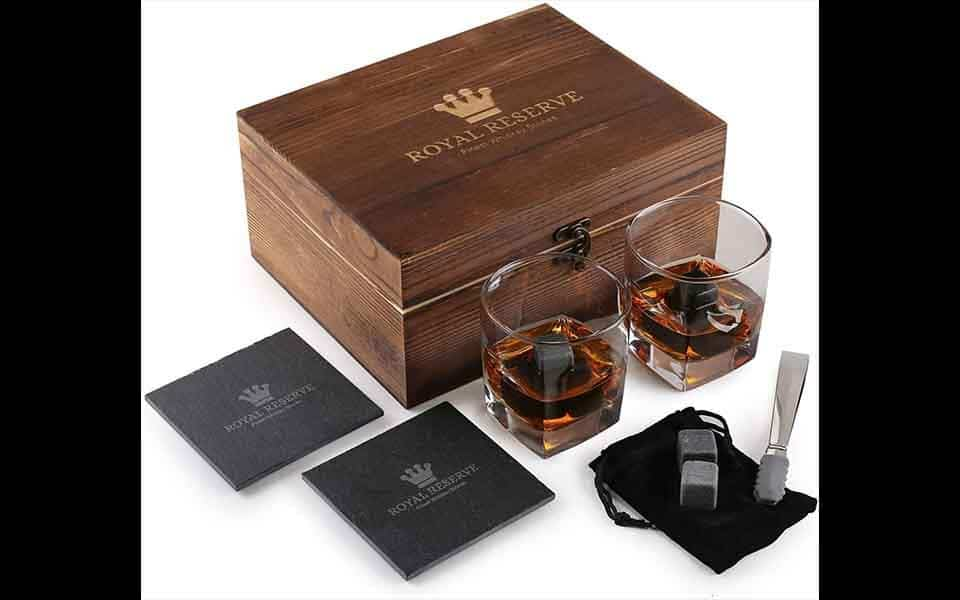 best groomsmen gifts: wooden box with whiskey in two glasses