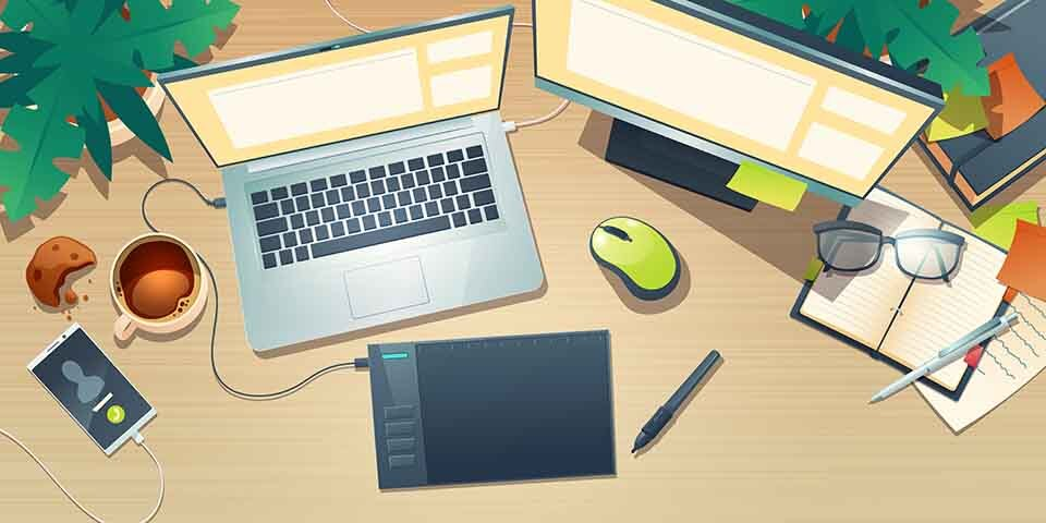 Top view of designer workspace with graphic tablet