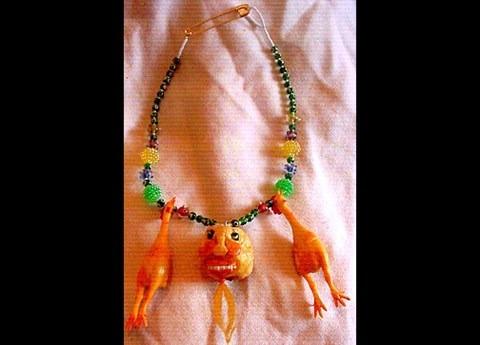 featherless chicken necklace