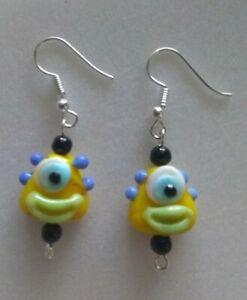 one-eyed monster clown earrings