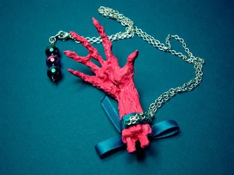 pink mummy hand necklace