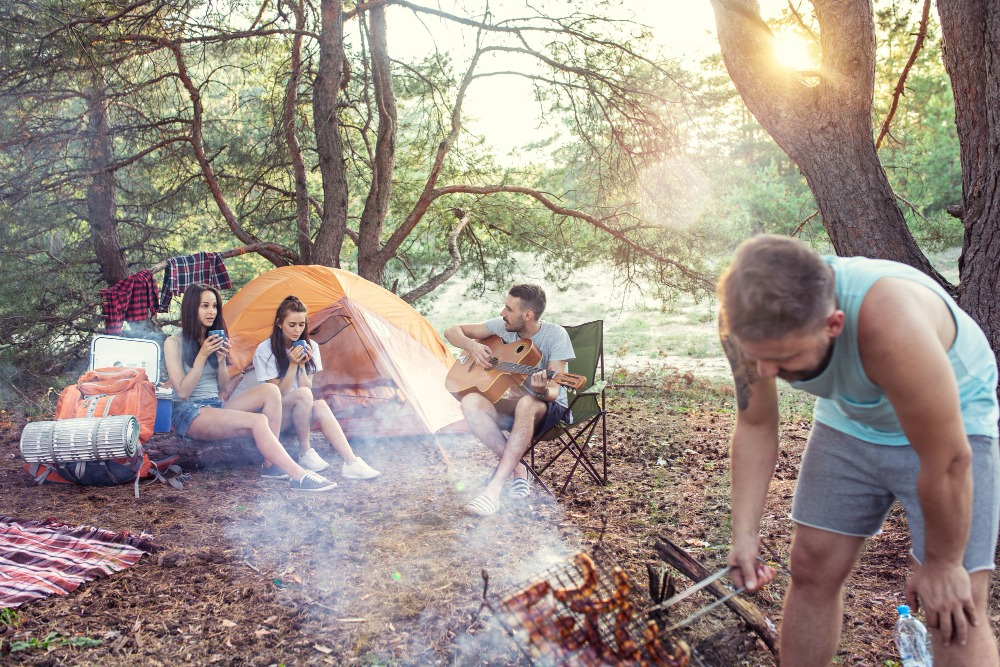 senior picture ideas guitar playing camping