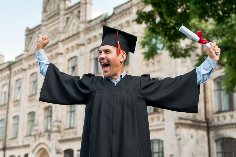senior picture ideas wearing gown in the campus